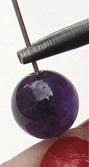 glass bead placed on eye pin